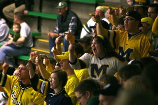 Michigan fans celebrate after a goal is scored.